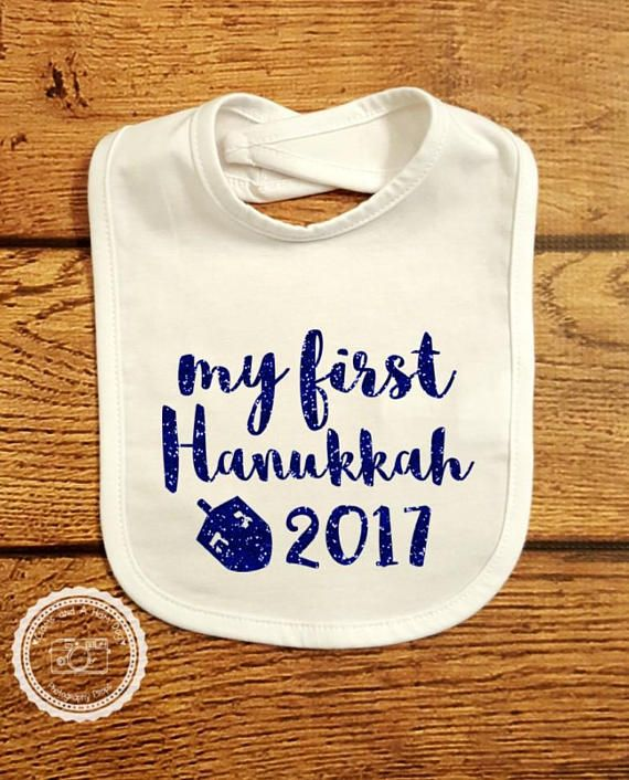 Baby Bib with my first Hanukkah 2017 design. This bib is perfect for both boys and girls! Lets encourage our children through intelligence, humor & love in all that they do! Choose your favorite color combination from the list below Listing is for Bib only. Accessories are available