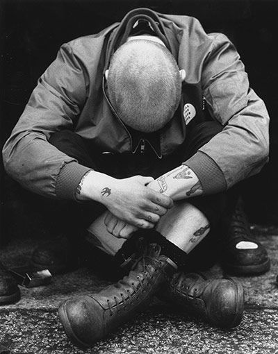 Credit: Stuart Nicol/Getty Images A skinhead sitting cross-legged during a British Movement rally in Notting Hill in 1980