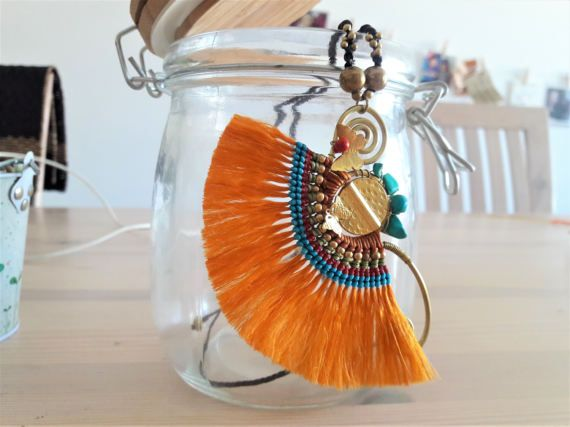 Welcome to Bohemian Style Statement Pieces...  Youre looking at a dazzling bright orange fringe pendant necklace, complete with butterfly motifs, red and turquoise howlite stones. Totally adjustable in length to wear to suit your style.     www.bohemianstyleshop.etsy.com