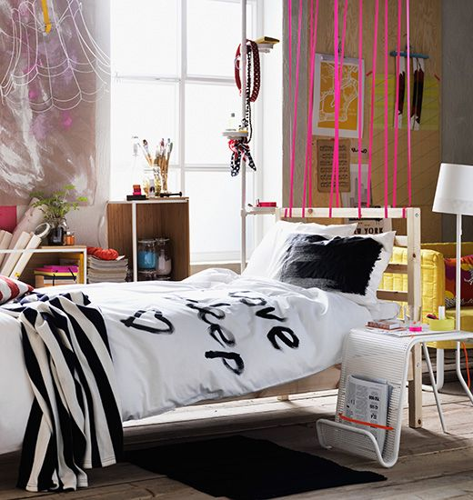 Closer view of single IKEA bed with black and white personalised bed linen.
