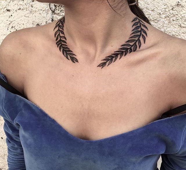 Gorgeous laurel leaf necklace tattoo