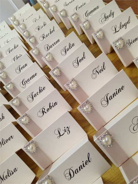 Name cards with champagne satin ribbon and pearl diamante for Table design names