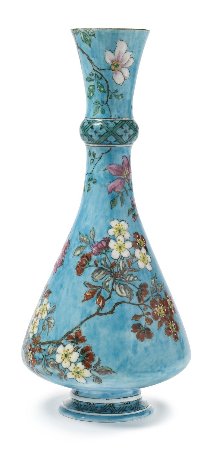 A THÉODORE DECK FAÏENCE TURQUOISE-GROUND BOTTLE VASE CIRCA 1870 decorated around the body in colorful enamels with flowering branches, the ringed shoulder decorated with diaperwork, TH DECK in black script.