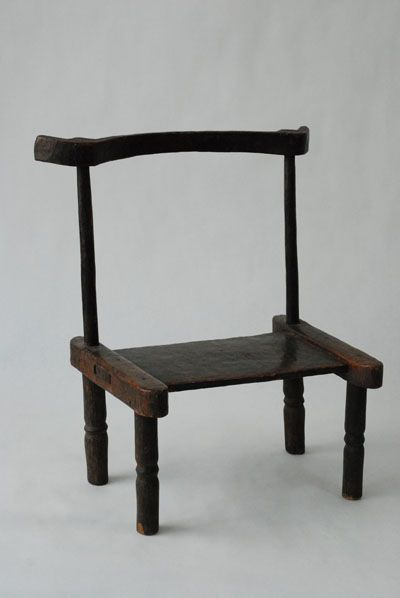 African Baule, Ivory Coast Chair  Baule, Ivory Coast, West Africa, chief's chair. 4 legged chair with traditional rails and curved b...