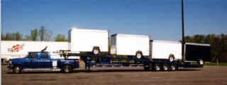 """8' X 51' Load Deck—PERFORATED DECK  3-7000 lb. Axles with Brakes on all Axles  9000 lb. Winch w/auxiliary battery  Tongue Wheel Ramp w/Storage rack  Center Track  36"""" Underbody Toolbox  4 Sliding Ball Towers  Steel Coated E-Mod Wheels  16 Wheel Loops with Ratchets  Adjustable Hitch with Ball Coupler or SAE Kingpin"""