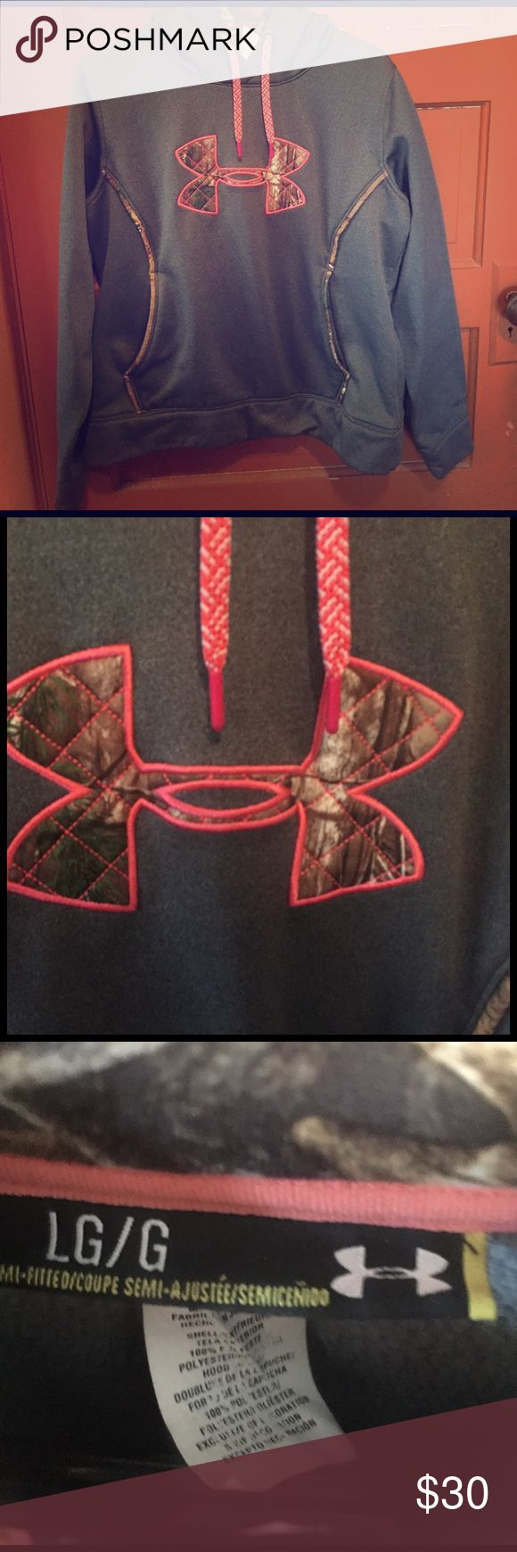 Under armor hoodie This hoodie is under armor and its is a size LG/G it  has not wear to it only worn one or two times. The symbol is pink with camouflage and in the hood its also camouflage Under Armour Sweaters