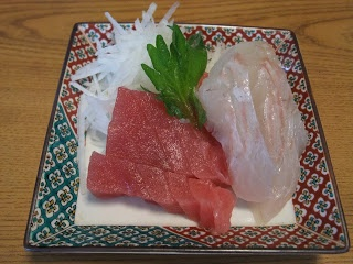 Traditional Japanese New Year dishes. Sashimi of sea bream and tuna