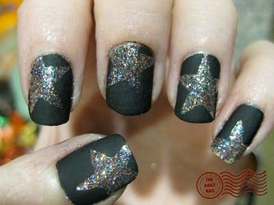 do as many coats as you want of your glitter polish, dry, one coat of top coat, dry.  Place a star sticker (one that teachers give out) in any way you want and then do two coats of matte nail polish, just make sure the sticker doesn't move. Then while the matte is still tacky take of the stars, then finish with top coats.