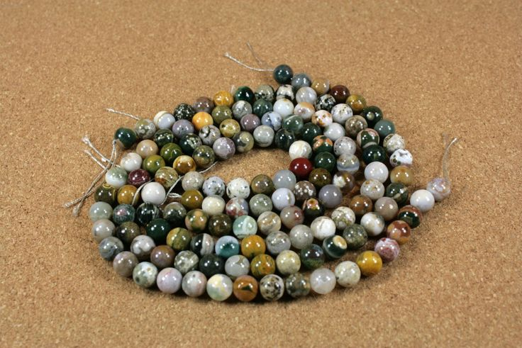Ocean Jasper Round Beads Multicolored Smooth Jasper Beads - 16 inch strand These beads are just gorgeous! Many different colors and patterns are seen throughout each strand. Definitely one of a kind strands. These beads measure 9 mm round.