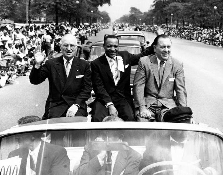 Chicago's Bud Billiken's Day parade 1956. President Harry Truman, John Sengtacke (creator of The Chicago Defender), and Mayor Richard J. Daley greet the crowd.