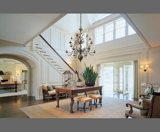 A soaring (preferably double height), panelled hallway announces your Hamptons style home to guests in dramatic fashion. Oversize lighting is a must
