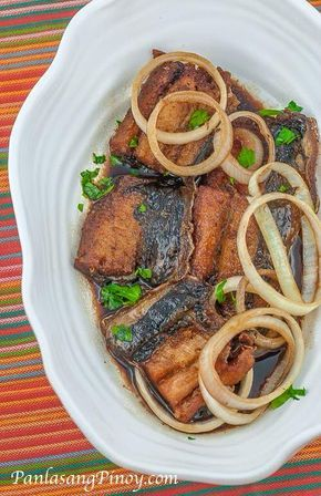 Filipino Fish Steak Recipe 1/3   Ingredients belly of 2 milkfish, sliced 1 medium yellow onion, sliced Juice of 1 lemon 3 cloves garlic, crushed Salt and pepper to taste 1 teaspoon chopped flat leaf parsley ¼ cup soy sauce ¼ cup water ½ cup cooking oil