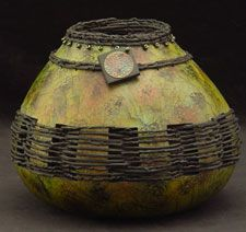 Sue Brogden ~ this is art, but great idea. I have no problem drying gourds, never considered mixed media with weaving and beadwork!
