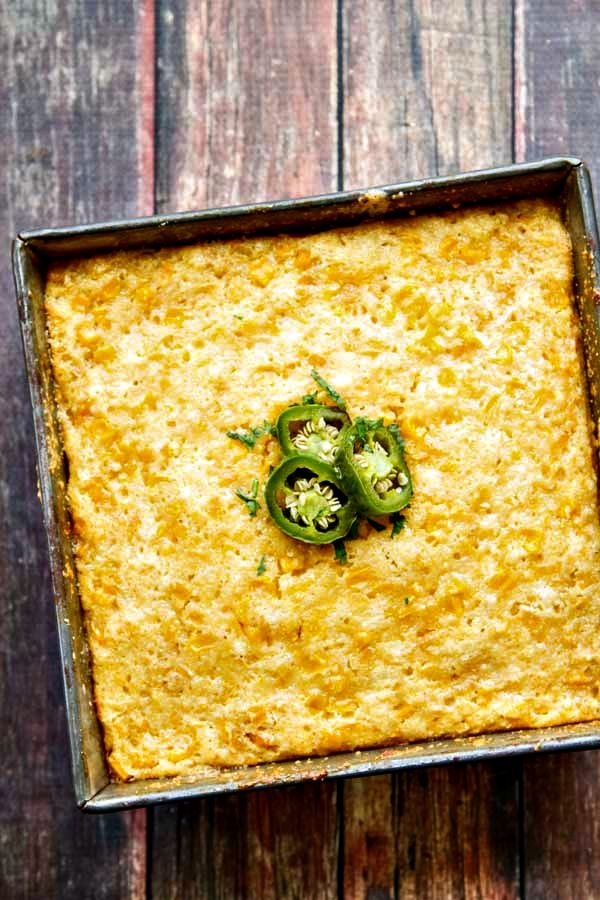 Not quite cornbread and not quite corn pudding, Sweet Corn Cake is an easy six-ingredient side that is perfect with any Mexican meal!