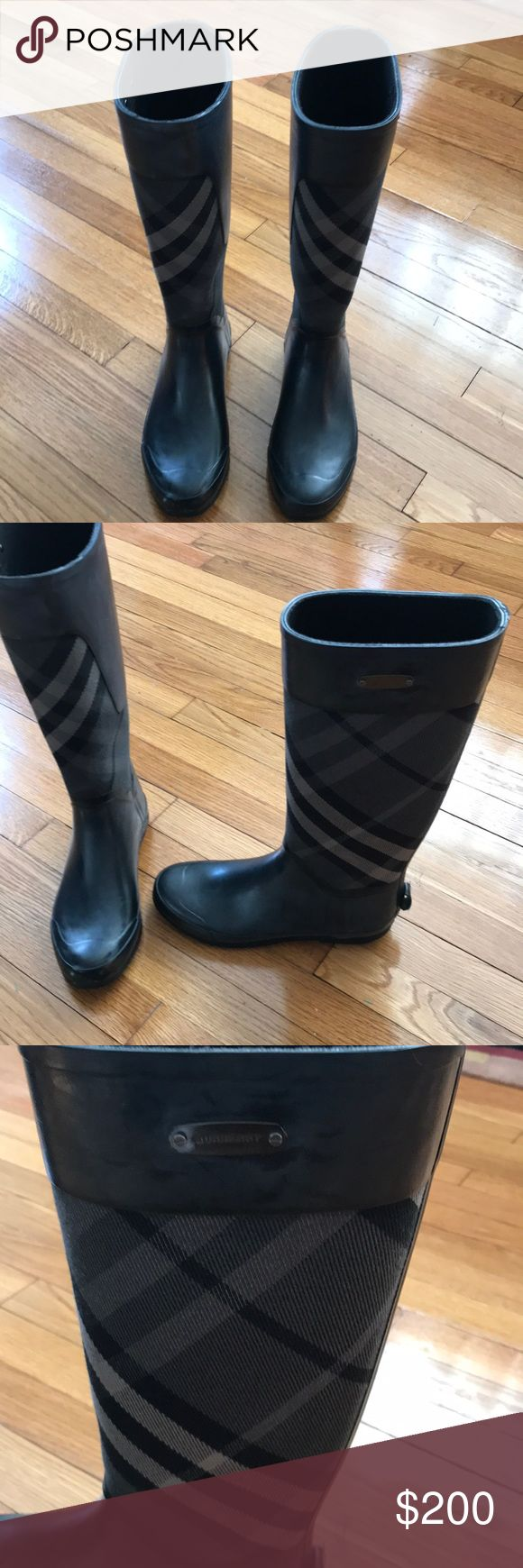 "Burberry clemence rain boots - charcoal Originally purchased from Nordstrom a few years ago, but only worn a handful of times.   Synthetic rubber with signature Burberry check on the coated cotton center  Burberry metal plate on outside leg 3/4"" flat heel Approximately 15"" shaft with 16"" top circumference  These run small - I am normally a size 8 Burberry Shoes Winter & Rain Boots"