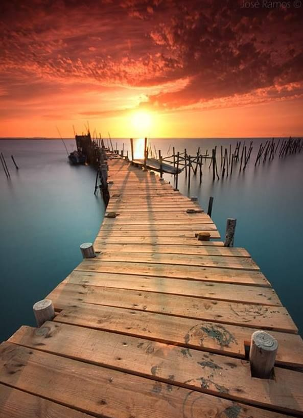 """Good morning to """"you"""". The first step to the morning being good…is you get to decide it's going to be a beautiful day.Think about this…the sun is rising on this weathered pier. The new wood laid down is a new direction veering off fromthe old…that's fading away. This is a great metaphor for life. Every day is new, every new direction has endless beautifulpossibilities. Make the decision it's going to be great, be optimistic, expect great things to happen…and give it your all.Those who hav..."""