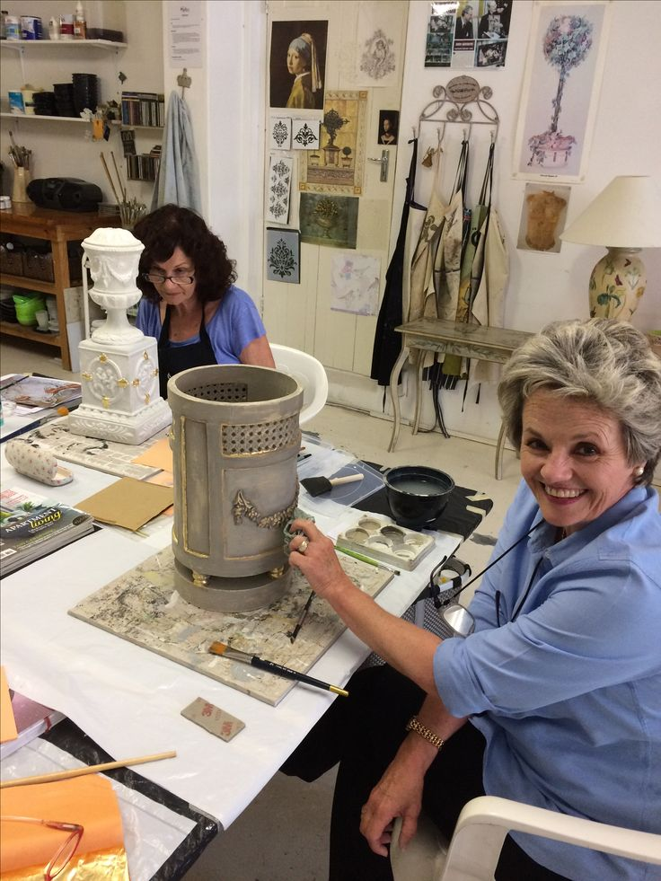 Nancy is working on this cement umbrella stand using gold leaf and dri-brushed with Annie Sloan Chalk Paints. A work in progress! Wendy can be seen fine painting a Venetian lamp base in the background.