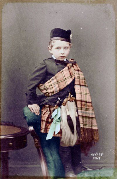 """Kaiser Wilhelm II, age 4, visits his beloved """"Granny"""" (Queen Victoria) at her Scottish estate at Balmoral. Someone has costumed him carefully so as not to reveal his lame left arm. 1863."""