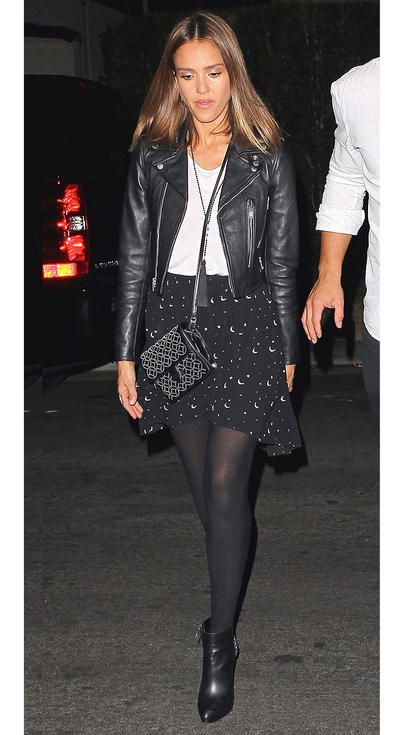 Jessica Alba in a black printed skirt, tights, booties, and leather jacket - click ahead for more fall outfit inspiration