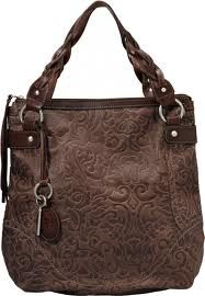 fossil... love this!  Shame though that every fossil purse I have has fallen apart! They make some cute purses!