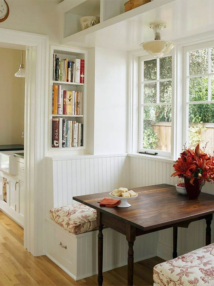 """""""Breakfast nooks result from the practical transformation of small, seemingly useless spaces. Previously an awkward corner, this space is now a convenient and purposeful area. Not just a place to sit down and grab a bite, the breakfast nook also boosts storage with shelves above and drawers below."""""""