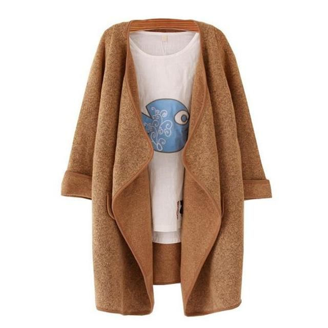 """This boho sweater coat is the ultimate blend of relaxed and chic. Get your hands on it by clicking """"visit."""""""