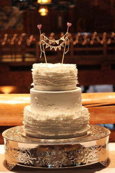 Romantic and ruffled wedding cake at Sunriver's Great Hall, by Sweet and Swanky Cakes in Bend, OR