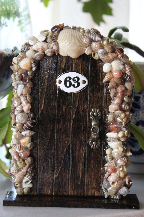 Previous Pinner said : This is so cute!  TheFabledDoor  Handmade storybook jewelry and fairy doors   Miniature Wood Fairy Hobbit Door Dark Seashells