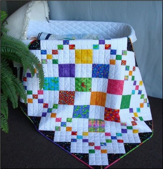 simple pattern with a big impact - baby quilt with bright colors