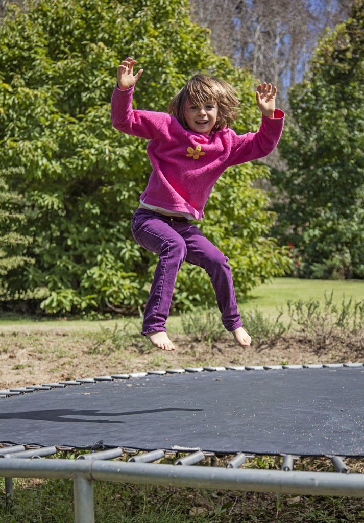 Annie jobs on the trampoline in a great shot caught by our photographer Elisabeth Calmes of Limelight Photography