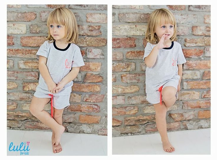 Our baby-angel in grey pyjama with fluo print and ribbon.