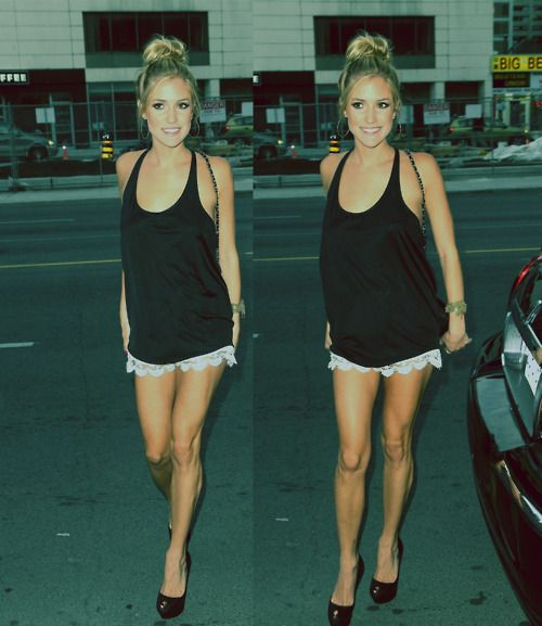 Kristin Cavalari. Black tank & platforms with lace shorts & topknot.