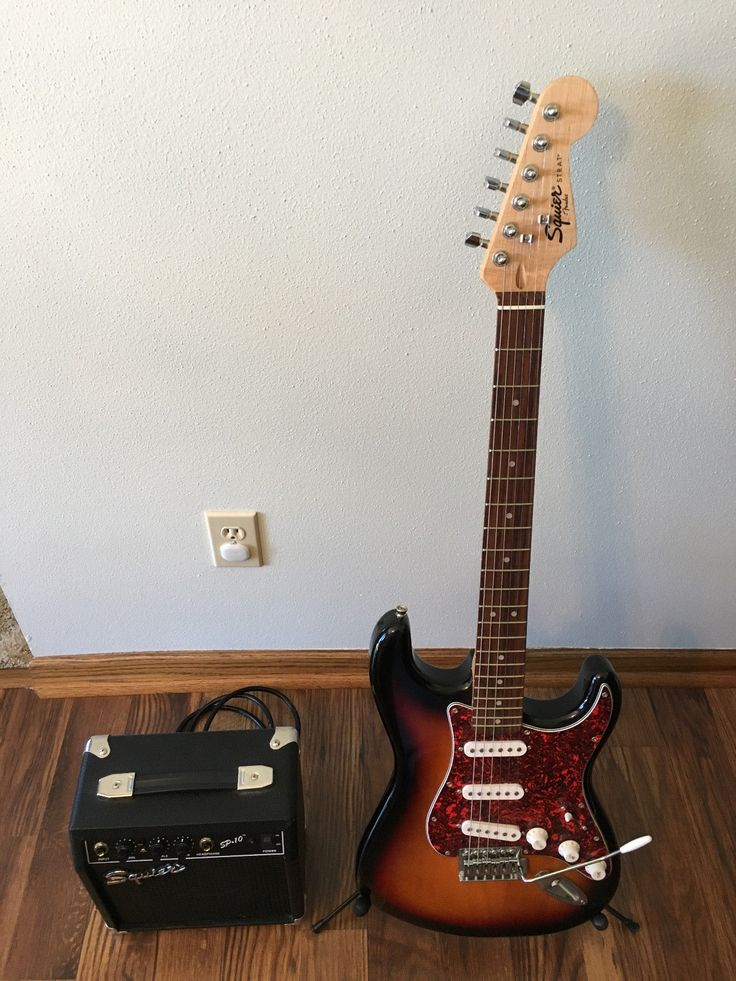Fender Squier Strat Electric Guitar Pre-owned w/Amp,Stand,Tuner,Case and More!