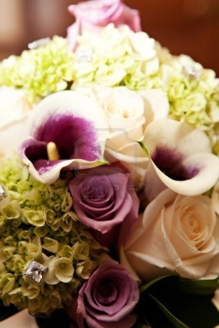 A beautiful flower arrangement with roses, calla lilies and diamonds Stock Photo