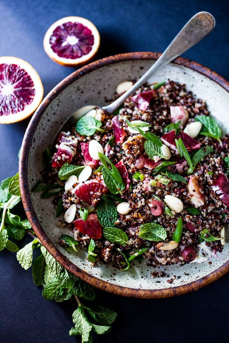 A simple Moroccan Quinoa Salad with blood oranges, almonds, olives, mint and a blood orange dressing. Pair this with Moroccan Salmon for a quick healthy meal. | www.feastingathome.com