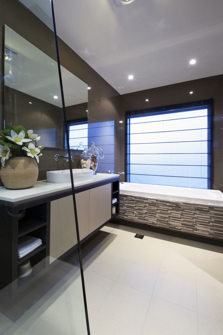 Elegant and sophisticated floating, wall mounted vanities as pictured here is a designers dream. This floating vanity creates an illusion by making the space feel bigger than it really is. See this in our Chifley display at Homeworld Gledswood Hills. For more info visit : http://www.rawsonhomes.net.au/display-locations-overview.php