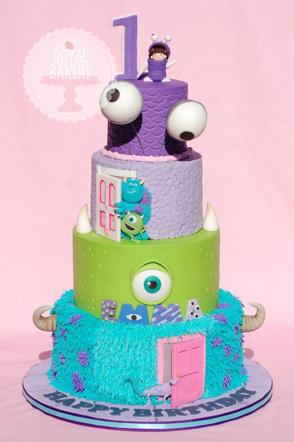 """4 tiers of Monsterness for Emma's first birthday party. 10, 8, 6 and 4"""" tiers of Sulley, Mike Wazowski, Randall the baddy and baby Boo. Nobody told me that grass tipping a ten inch tier would take three hours and be quite so agonizing. ;-)"""