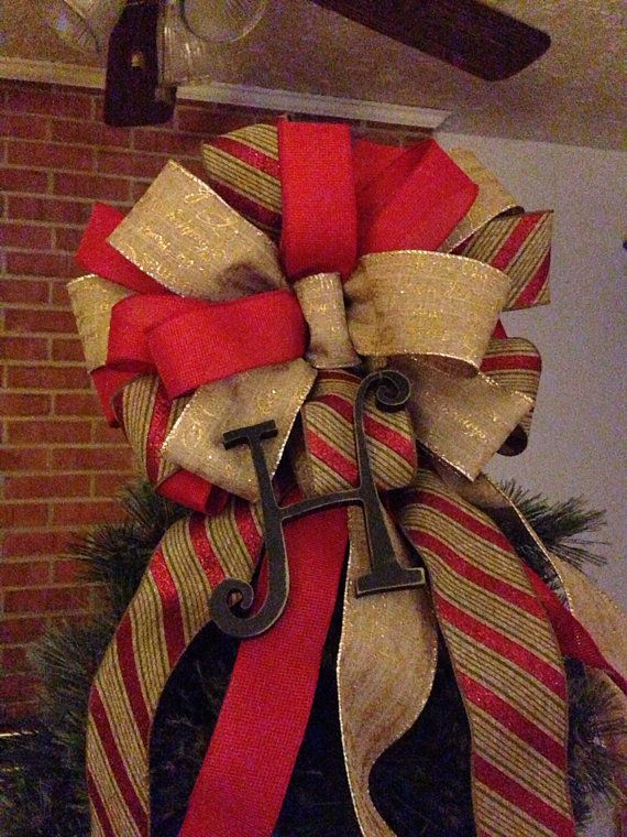 Christmas tree topper bow with -monogram got to find me someone to make a bow for my tree would love to have one like this!!