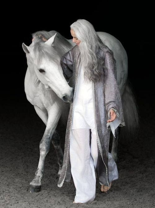 BEAUTIFUL long gray and white hair. They wear it well.  TWIST: same color hair as cat's hair. (gray and white)