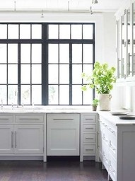 Luscious kitchens - mylusciouslife.com - iron windows, modern long pulls, light gray (?) cabinets  #kitchen