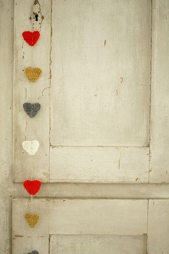 felt, fabric, or crochet hearts - various sizes, sew sequin, bead, or small button in center. vertical chain for front door, hang among framed photo group. horizontal for garland across top of doorway, along edge of bookshelf, down a hall's wall. so many ideas!
