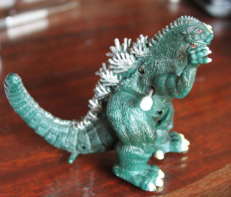 Toho Trendmasters 1994 Wind Up Godzilla Toy Figurine Action Figure. My brother didn't have a windup but instead had one with a red button on its chest with roaring sound effects