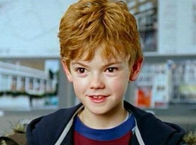 Thomas brodie sangster in Love Actually. What a talent. He breaks your heart.  He is fine in Game of Thrones too.  Hard to believe he is 23. He'll always be this kid for me. JC
