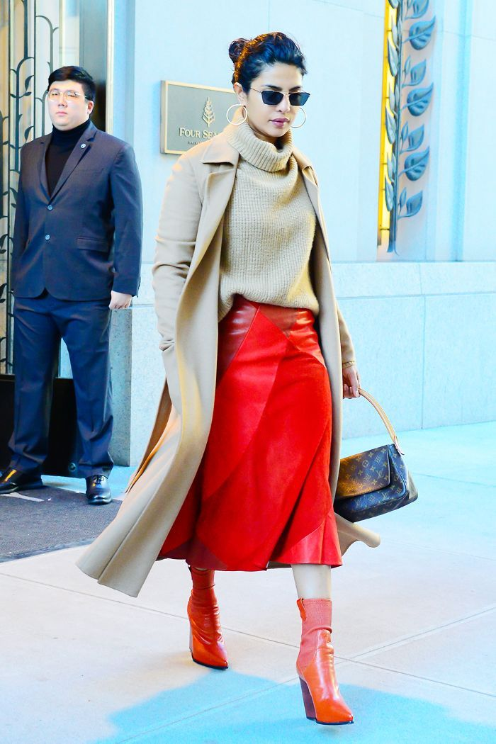 cb31d59d2d17 Celebrity winter outfits  Priyanka Chopra wearing red skirt and camel coat