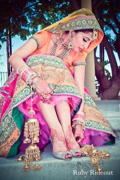 Colorful #Punjabi Bride via http://rubyrideout.com/ ~ #Desi #Indian_Wedding Photography, Az, Ca, USA. Jewelry includes Chooda & Kalire on wrist, Haath Phool on hands (Narrower Borders better for Petite)