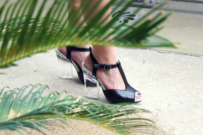 We spotted the blogger behind www.frenchinlosangeles.comhanging out in ALDO's lucite heeled sandals on a trip to a green house.   See the shoe here: http://bit.ly/aserrius See the full look here: http://bit.ly/12gOsYk