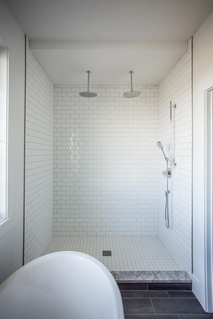 Crisp white brick tile in this oversized walk-in shower!
