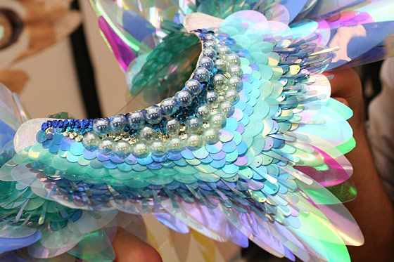 """Behind the Scenes: Victoria's Secret Fashion Show    """"This piece wraps around the neck in two sections. It's made of sequins and plastic; everything was applied by hand. The iridescent sequins will change color with the light."""" — Juliette Meurisse"""