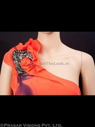 Check out this hot orange one shoulder dress which was selected for Bipasha Basu but not used in the movie 'Jodi Breakers'. The bright orange color is very catchy & the one shoulder print, a purple abstract print and an appealing length makes it very sexy & stylish. Flaunt your oomph factor in style with this party wear dress.