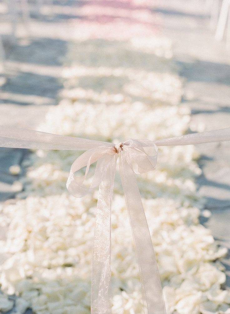 A dreamy petal lined aisle: http://www.stylemepretty.com/2016/03/09/30-must-haves-to-plan-the-ultimate-classic-wedding/
